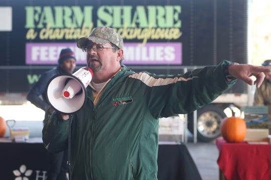 Dave Reynolds, Farm Share Facility Manager preps volunteers as Farm Share prepares to provide roughly 1,000 meals for families in Quincy, Fla., Friday, Nov. 16, just in time for Thanksgiving.
