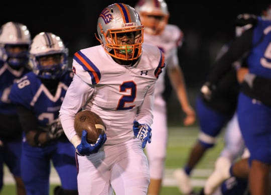 Bolles running back Jayden McCloud rips off a 20-yard run during a 32-27 win over Godby in a Region 1-5A semifinal at Gene Cox Stadium on Thursday, Nov. 15, 2018.