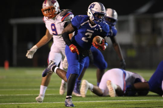 Godby senior running back Tony Street takes off on an 18-yard touchdown run during a 32-27 loss to Bolles in a Region 1-5A semifinal at Gene Cox Stadium on Thursday, Nov. 15, 2018.