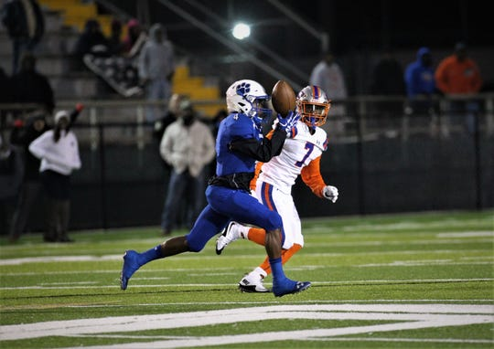 Godby junior receiver Alvin Jones barely manages to hang onto a pass during a 32-27 loss to Bolles in a Region 1-5A semifinal at Gene Cox Stadium on Thursday, Nov. 15, 2018.