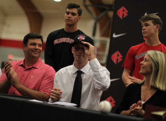 North Florida Christian senior baseball player Carson Neal signed with Valdosta State during a signing ceremony in the NFC gym on Wednesday, Nov. 14, 2018.