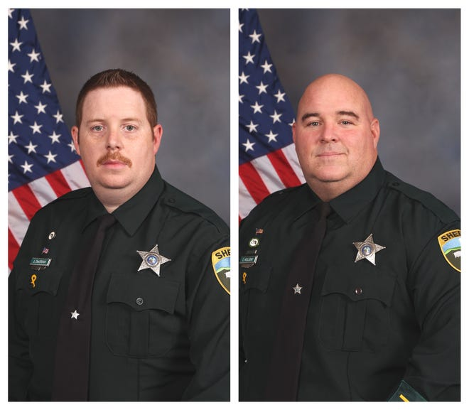 Deputies Jack DeGraw (left) and Chad Holliday saved a woman from a house fire