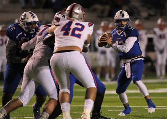 Godby junior quarterback Trey Fisher looks to pass during a 32-27 loss to Bolles in a Region 1-5A semifinal at Gene Cox Stadium on Thursday, Nov. 15, 2018.