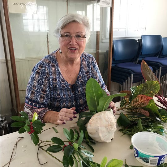 Barbara Peyton creates live decorations for display in the House of Refuge Museum from native plants and beach shells. Each year the by the Allamanda Circle of the Garden Club of Stuart and UF/IFAS Extension Martin County Master Gardeners host the House of Refuge Holiday Open House.