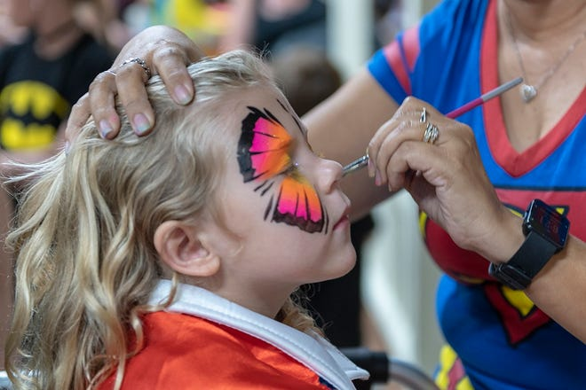 Even super heroes love to have their faces painted!