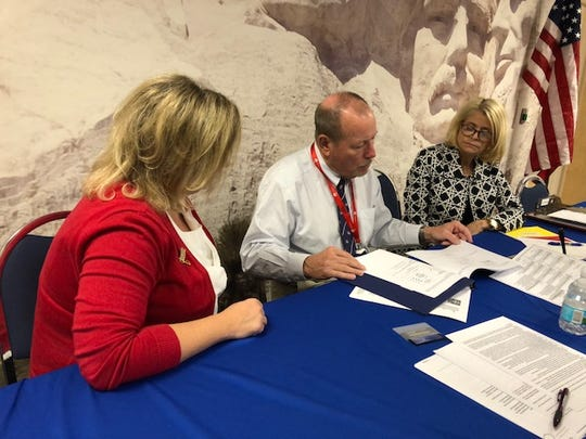 Susan Adams (from left), David Morgan and Leslie Swan look over Indian River County ballots in the state-ordered manual recount of ballots Nov. 16, 2018.