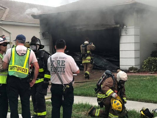 Fire officials said a Thursday afternoon home fire started in the residents' garage and left the home destroyed