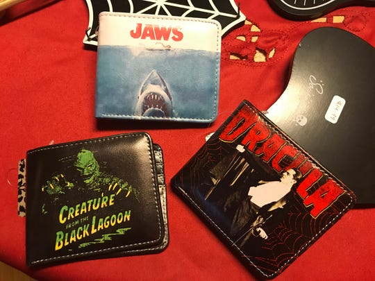 Forget those boring leather wallets. Young men will love these fun themed styles from Dreadful Things.