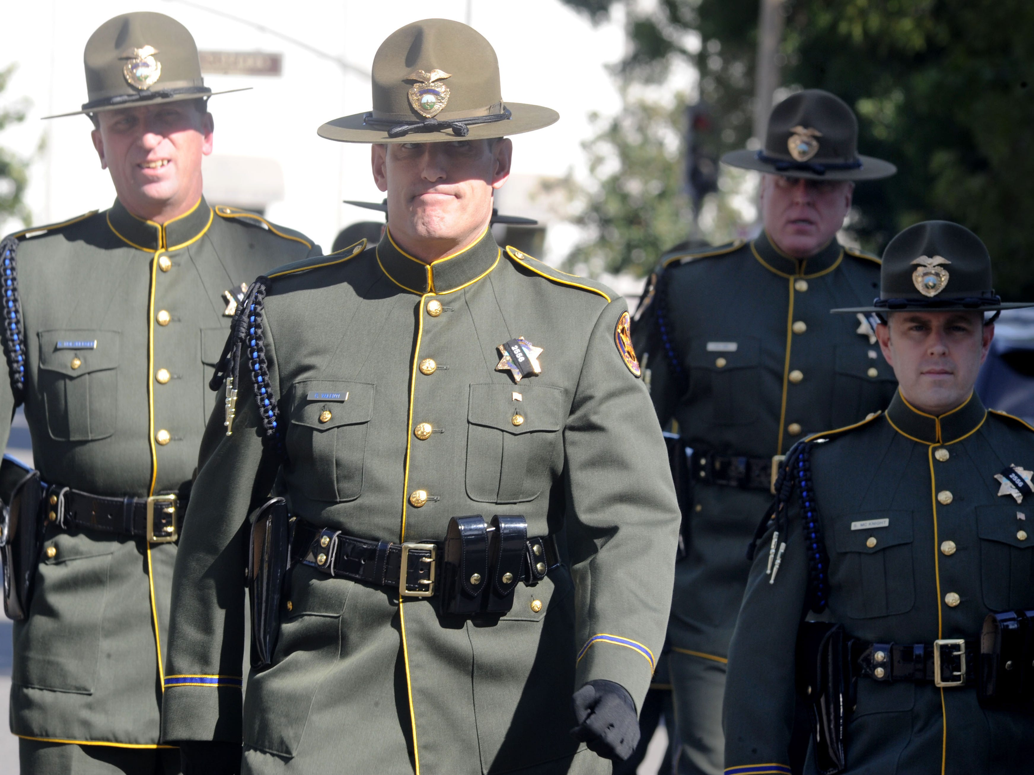 Law enforcement personnel walk into Calvary Community Church in Westlake Village Thursday to honor Ventura County Sheriff's Office Sgt. Ron Helus.