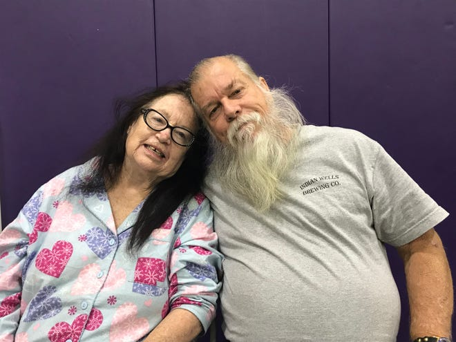 Corrine Morgan-Thomas, 65, smiles with her husband, Doug Thomas, 69, at California Lutheran University on Nov. 15. The couple lost their Malibu home in the Woolsey Fire and are thankful they were able to evacuate and stay safe at an evacuation center in the university.