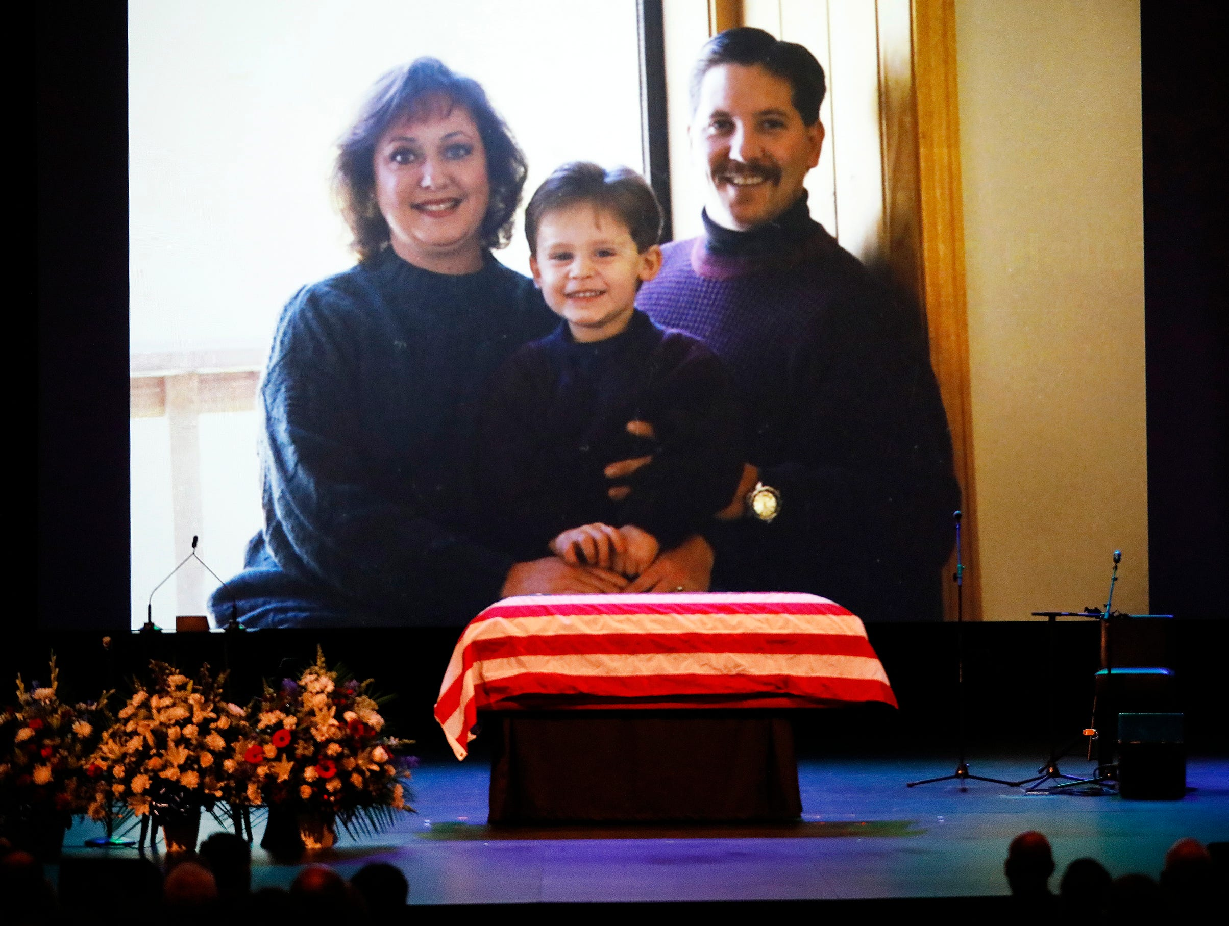 A old family photo of Ventura County Sheriff's Office Sgt. Ron Helus with his wife Karen and son Jordan is shown during a video montage at Calvary Community Church for his memorial service Thursday.