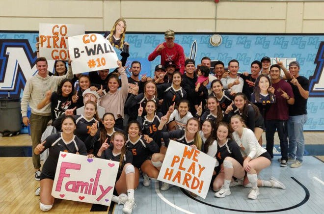 The Ventura College women's volleyball team celebrates its first WSC North championship in 13 years on Wednesday at Raider Pavilion.