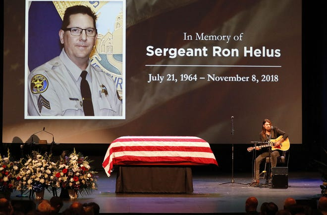 Billy Ray Cyrus sings during the memorial service for Ventura County Sheriff's Office Sgt. Ron Helus at Calvary Community Church in Westlake Village.