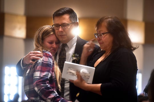 Brittany Villegas shares a hug with Mike and Martha Morisette during Friday's memorial service for Kristina Morisette, one of 12 people slain during a shooting at Borderline Bar & Grill in Thousand Oaks. Brittany and Kristina had been friends since the fourth grade.