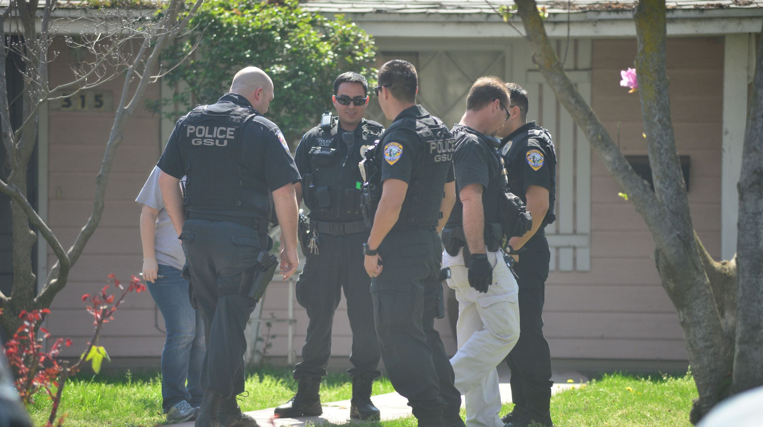 Two Visalia officers have been charged with multiple felonies stemming from a series of search warrants served in Tulare.