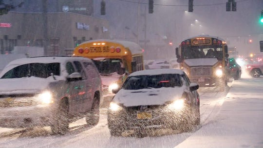 School buses stuck in completely stopped traffic on Westchester Avenue in White Plains during a steady snowfall Nov. 15, 2018.