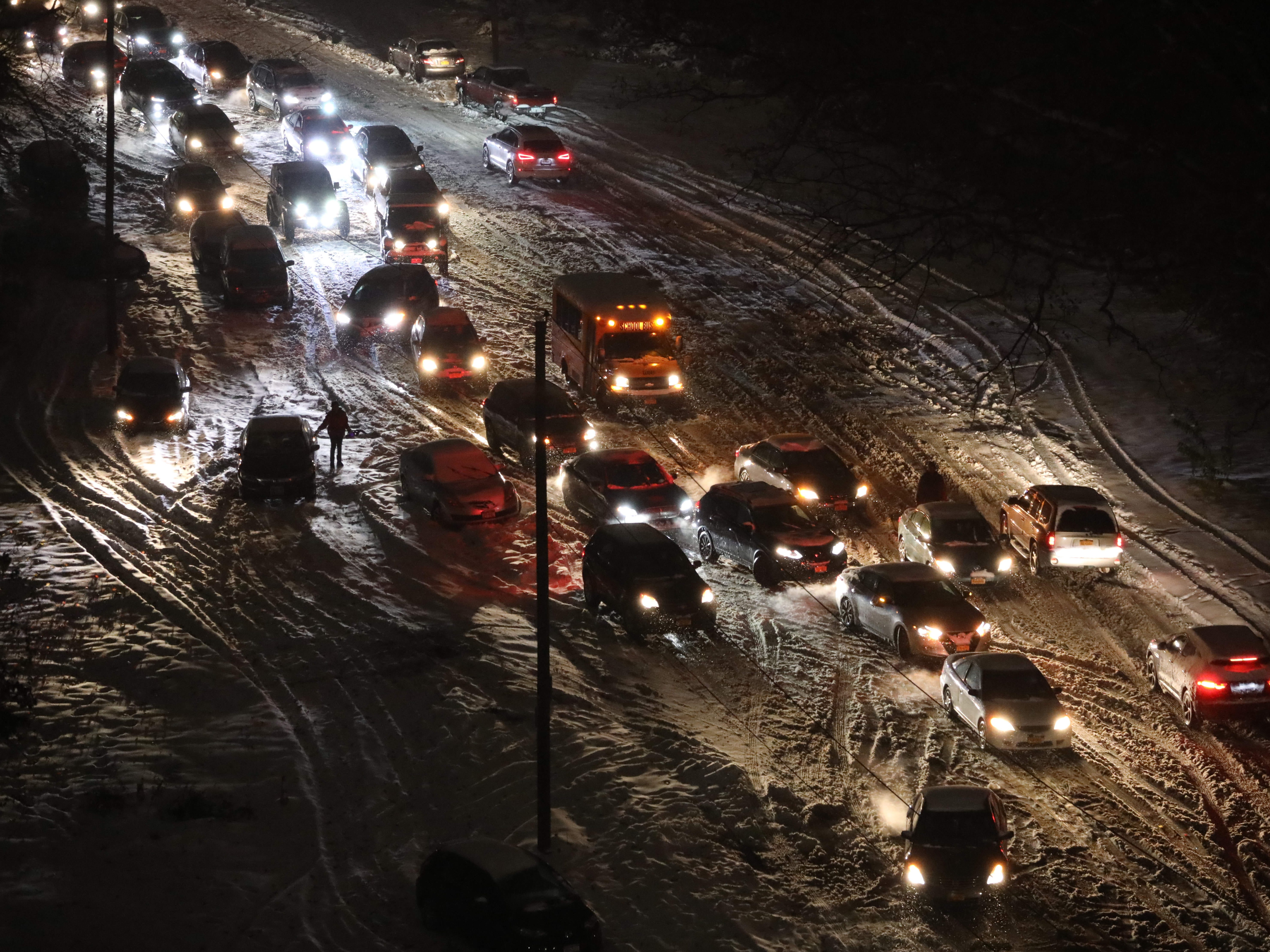 It's a virtual free-for-all as evening commuters try to navigate on icy snow covered roads, on the Rumsey Road access road to the Saw Mill River and Cross County Parkways in Yonkers, Nov. 15, 2018.