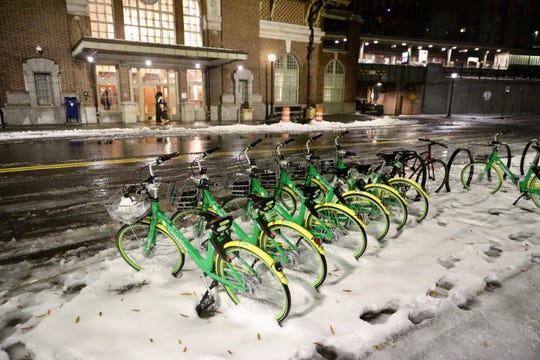 A row of Lime bikes sit in front of the Yonkers train station as early morning commuters make their way to work, Friday, Nov. 16, 2018.