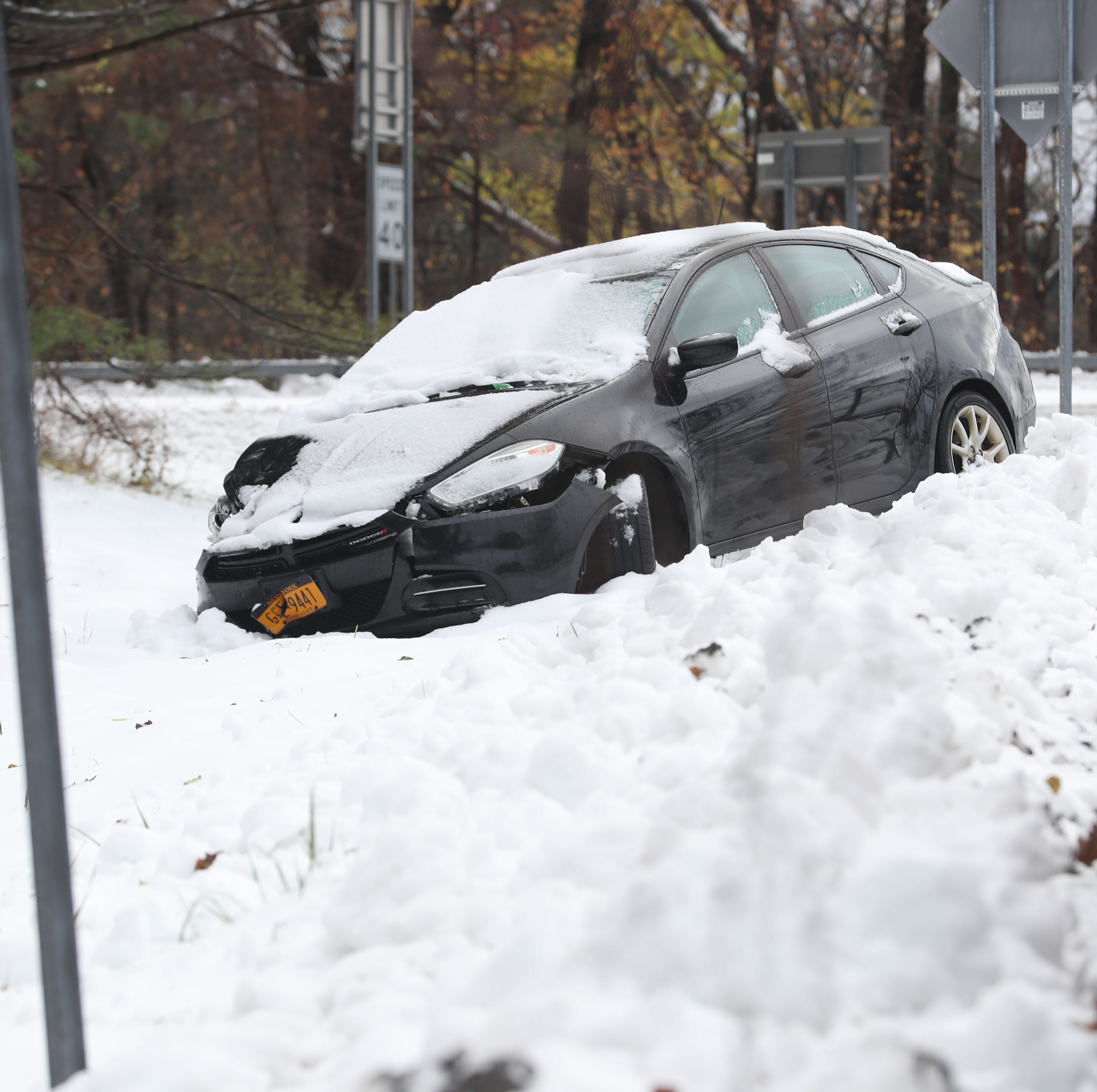 A car that was abandoned during last nights snowstorm sits on the side of I-684 in Katonah Nov. 16, 2018.