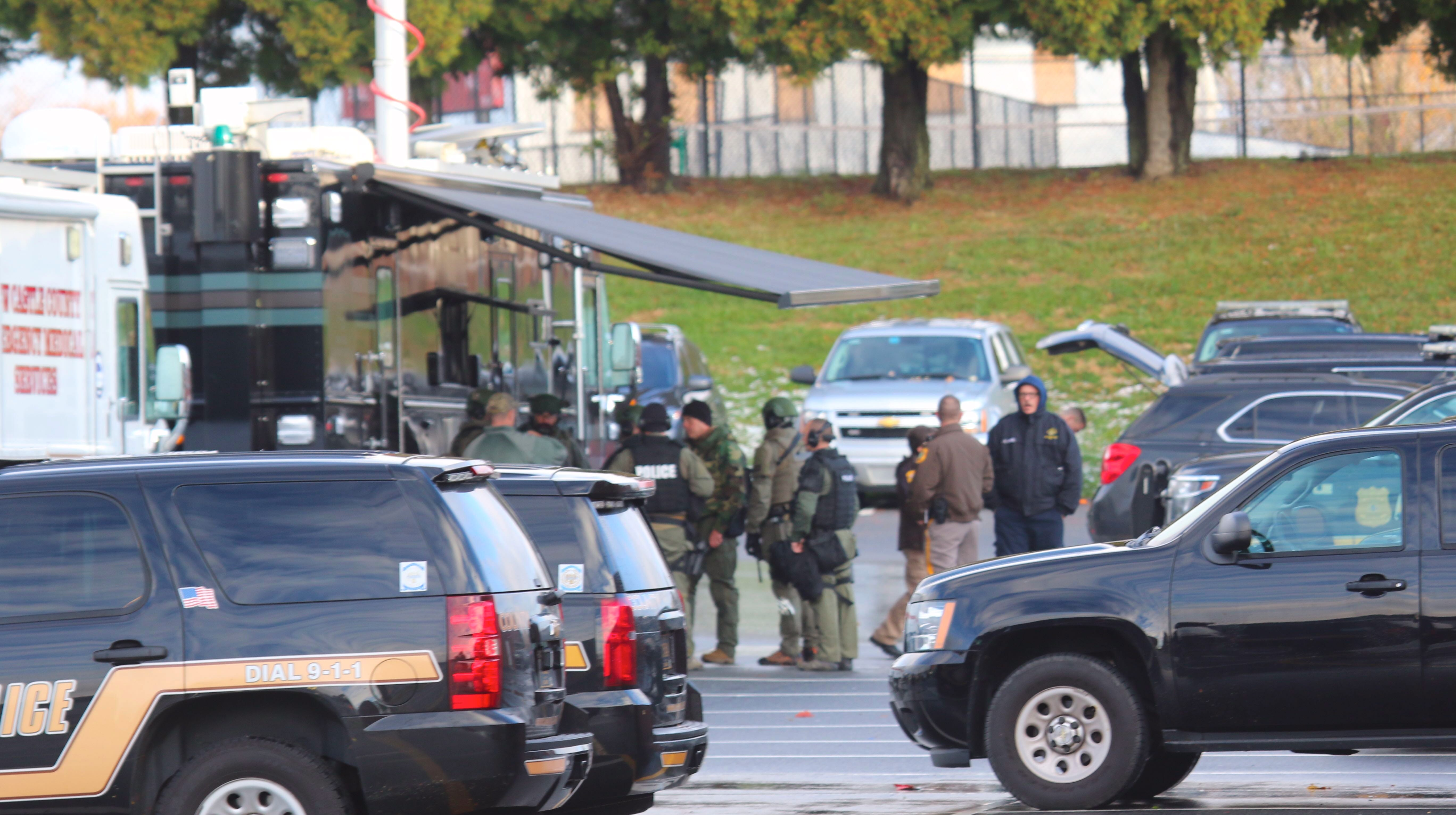 Police gather Friday morning in Bellemoor, off Boxwood Road, near Newport.