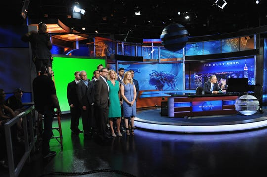 "John Hodgman, Lewis Black, Aasif Mandvi, Jordan Klepper, Steve Carell, Nancy Walls, Jessica Williams, Samantha Bee, Hasan Minhaj, Kristen Schaal and Al Madrigal appear on ""The Daily Show with Jon Stewart"" for Stewart's final episode as host in 2015."