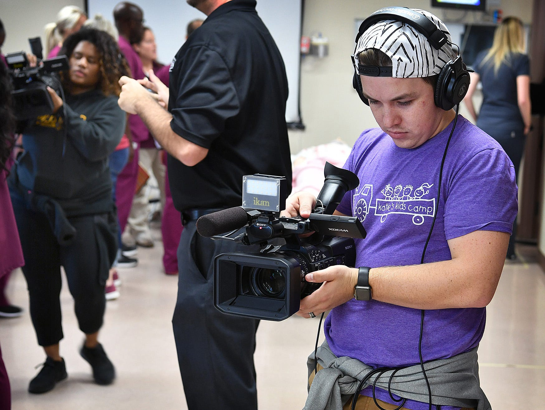 Mass Communications students participate in the Midwestern State University Interdisciplinary Communications Event Friday morning. The simulation involved two people critically injured in a bar fight and students from Nursing, Respiratory, Social Work, Mass Communications, Radiology and Theater.