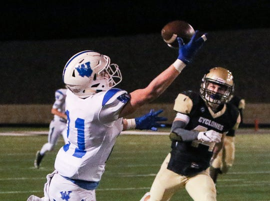 Windthorst's Awtry Blagg reaches out and makes the catch before running for a touchdown Thursday, Nov. 15, 2018, in the Region 2A division II bi-district game against in Vernon.