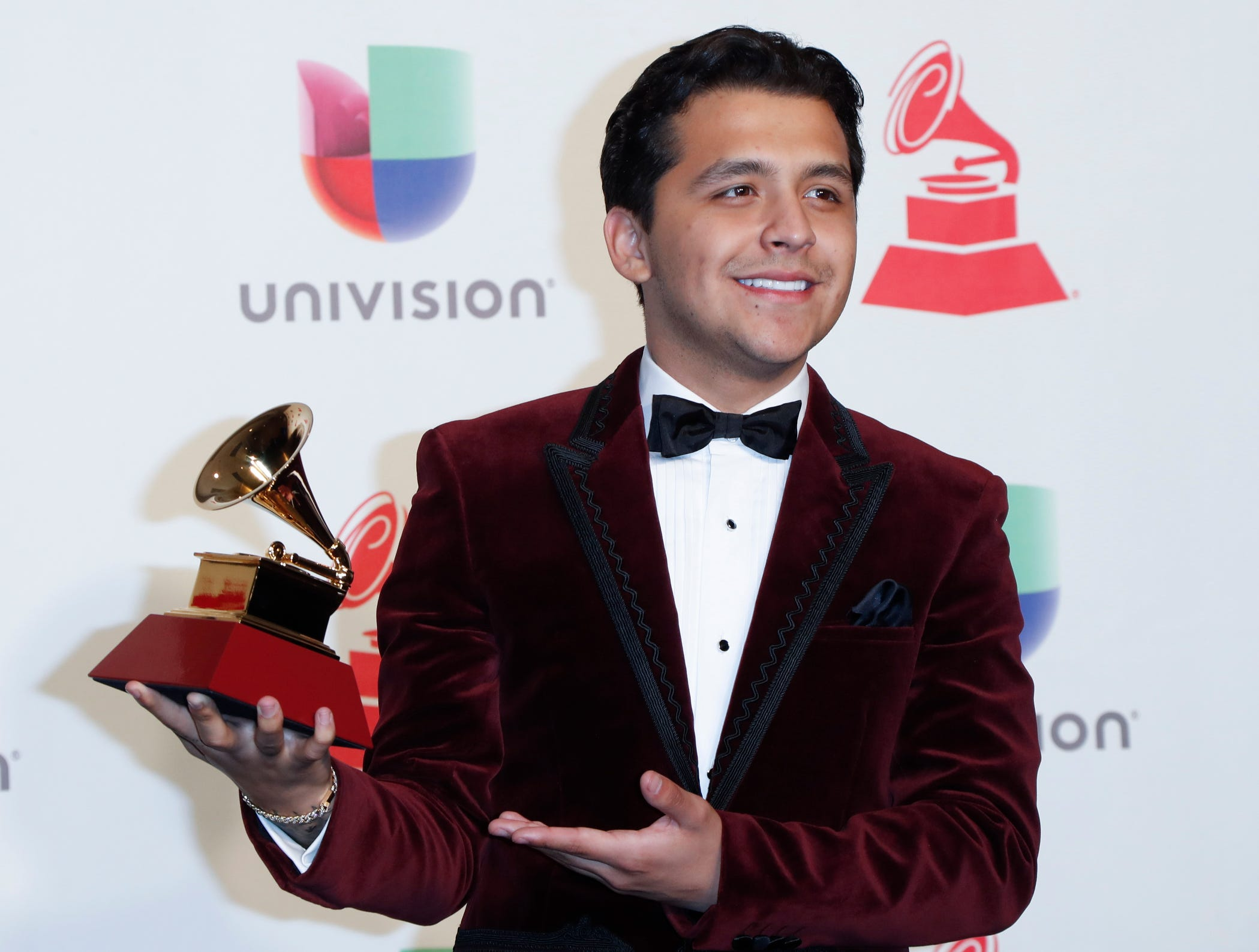 Christian Nodal with the award for Best Regional Song.