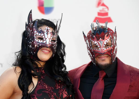 Kalisto and his wife, Abigail Rodriguez, wore coordinating masks for the 19th Annual Latin Grammy Awards.