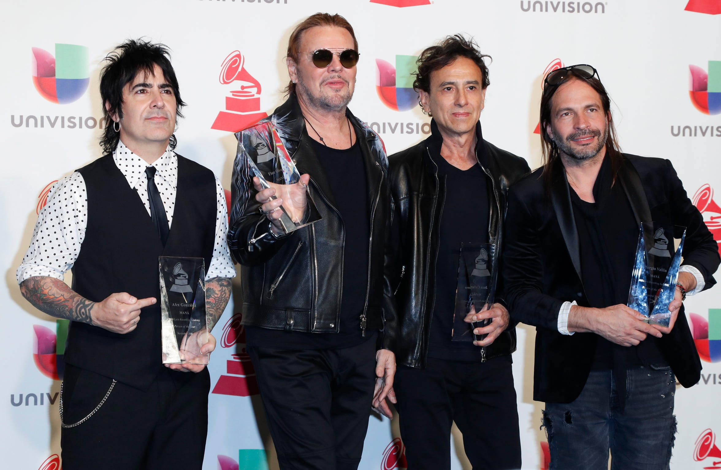 Mana are pictured after receiving the Person of the Year during the 19th Annual Latin Grammy Awards ceremony at the MGM Grand Garden Arena in Las Vegas, Nevada.