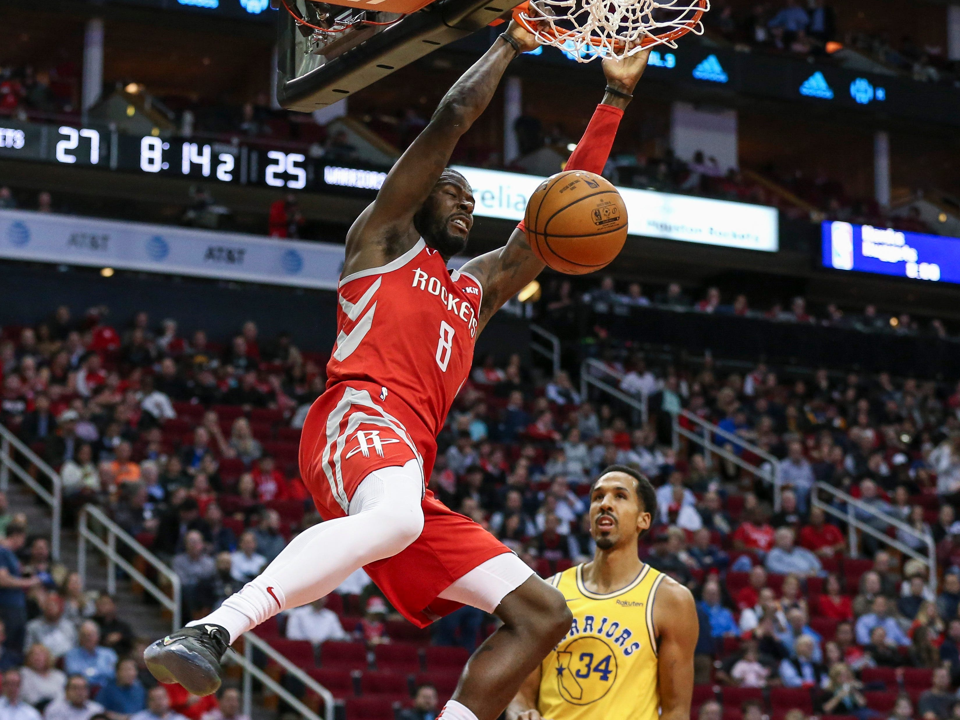 Nov. 15: Rockets forward James Ennis finishes off a two-handed flush during the first half against the Warriors in Houston.