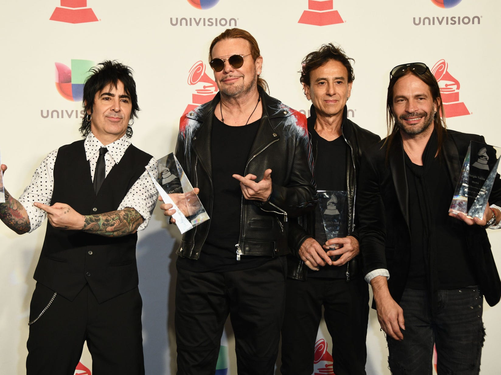 Members of Mexican rock band Mana Fher Olvera, Alex Gonzalez, Sergio Vallin and Juan Calleros poses with their Person of the Year awards.