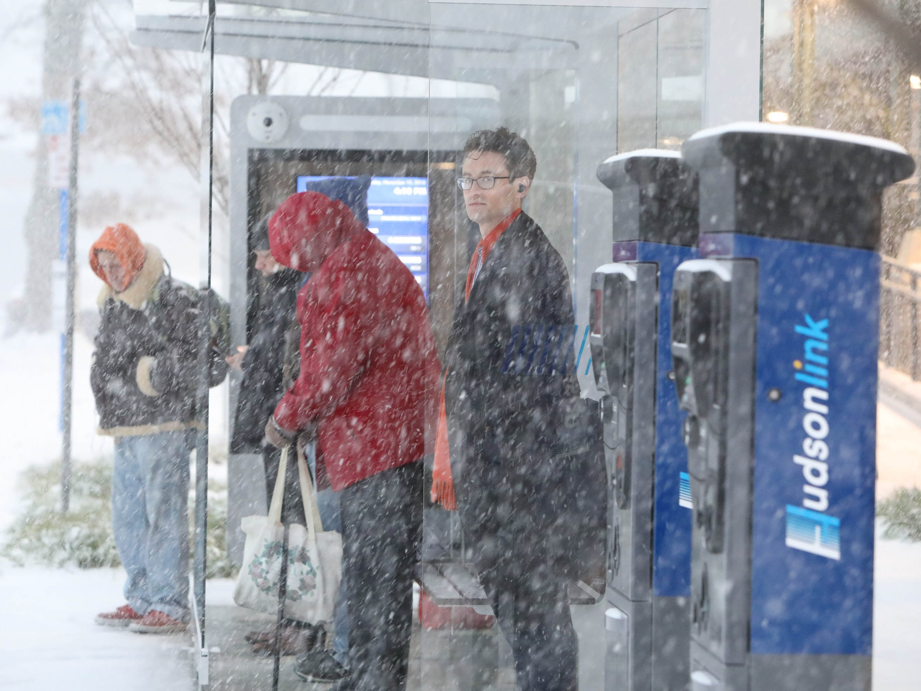 Commuters wait for the Hudson Link in Tarrytown, N.Y. which is operating on a delay during a steady snowfall for the evening commute Nov. 15, 2108.