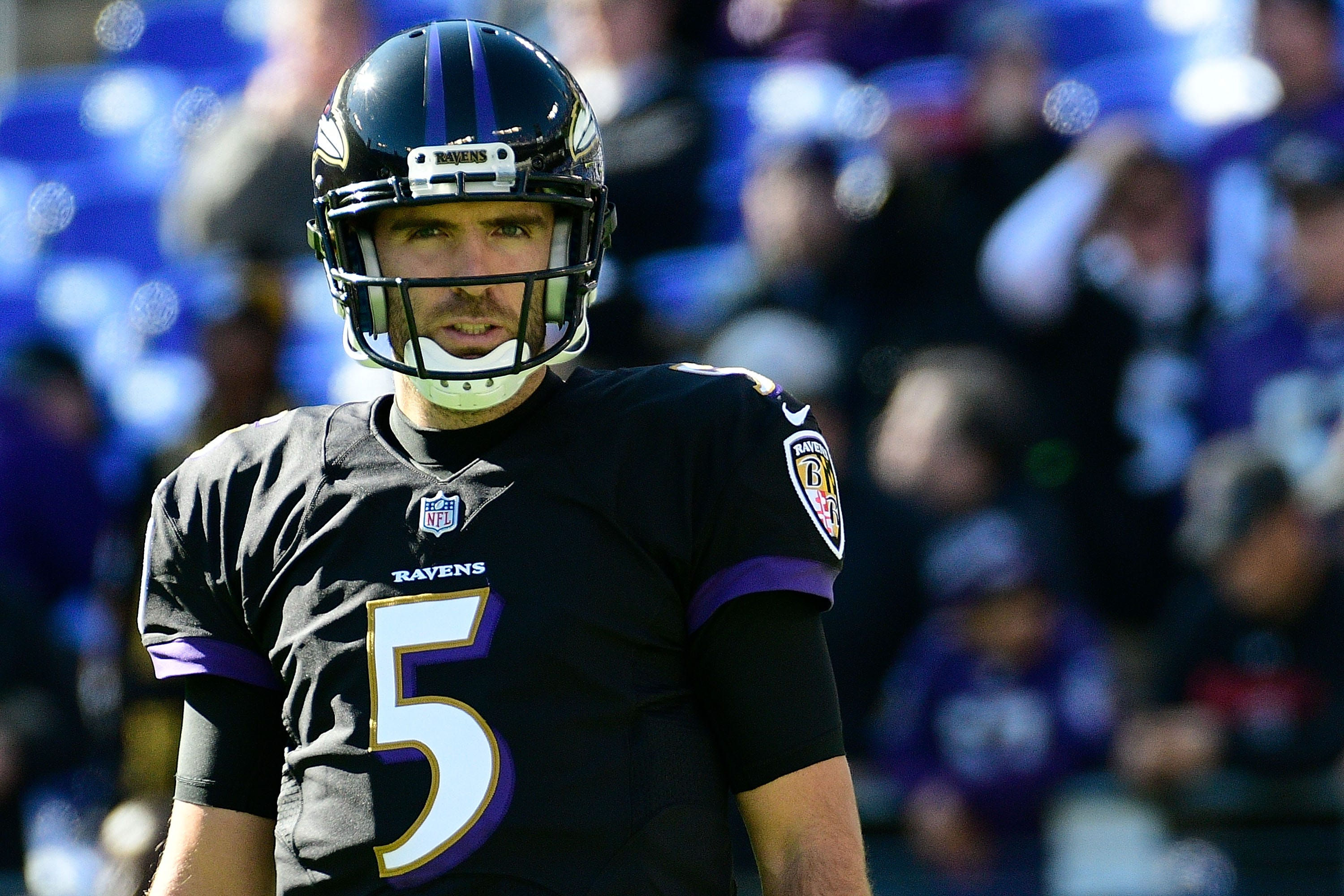 4caee64e4 Baltimore Ravens quarterback Joe Flacco (5) stands on the field before the  game against