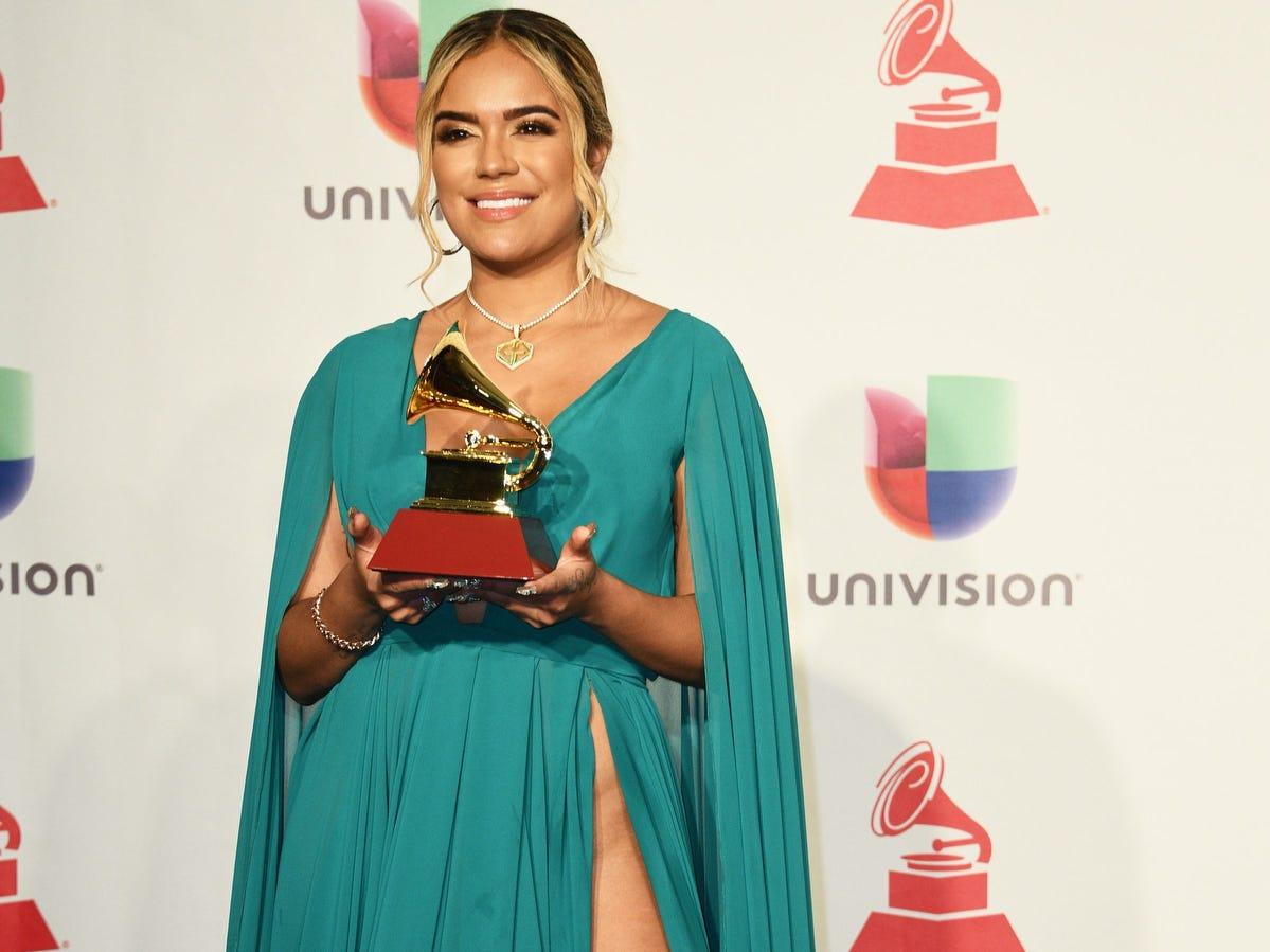 Colombian singer Karol G poses with her award for Best New Artist.