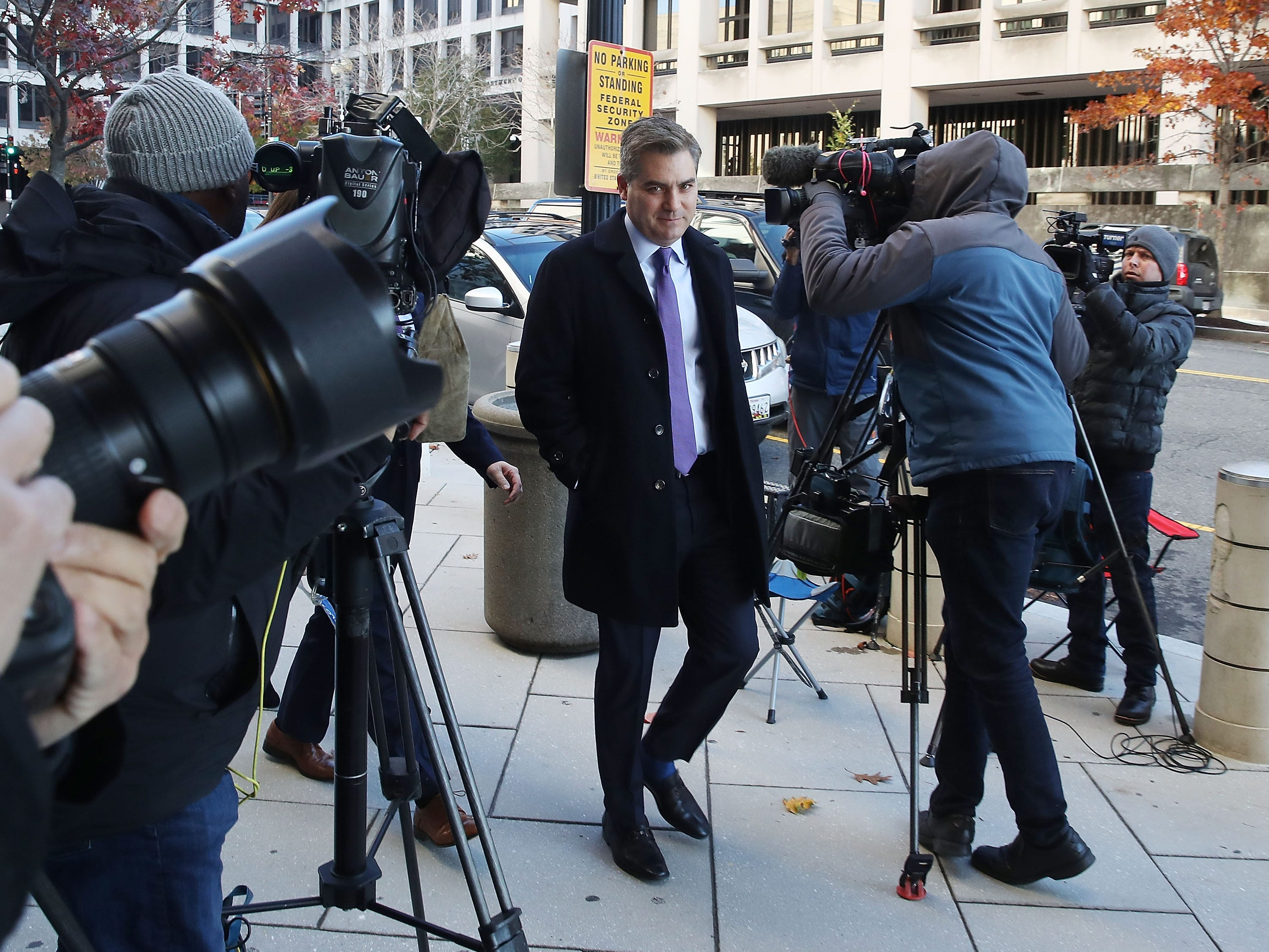 A federal judge ordered the White House on Friday to restore CNN reporter Jim Acosta's press badge, which had been revoked Nov. 7 after a contentious exchange at a news conference with President Donald Here,   Acosta arrives for the hearing at the U.S. District Court on Nov. 16, 2018 in Washington, DC.