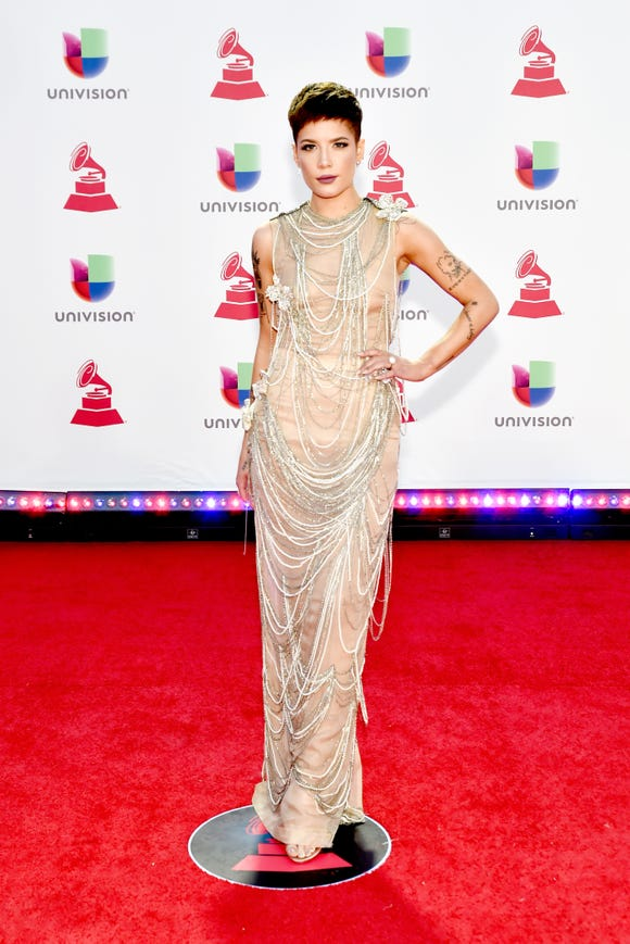 Halsey walked the red carpet for the Latin Grammy Awards in a nude dress adorned with rows of draped beads in light colors.