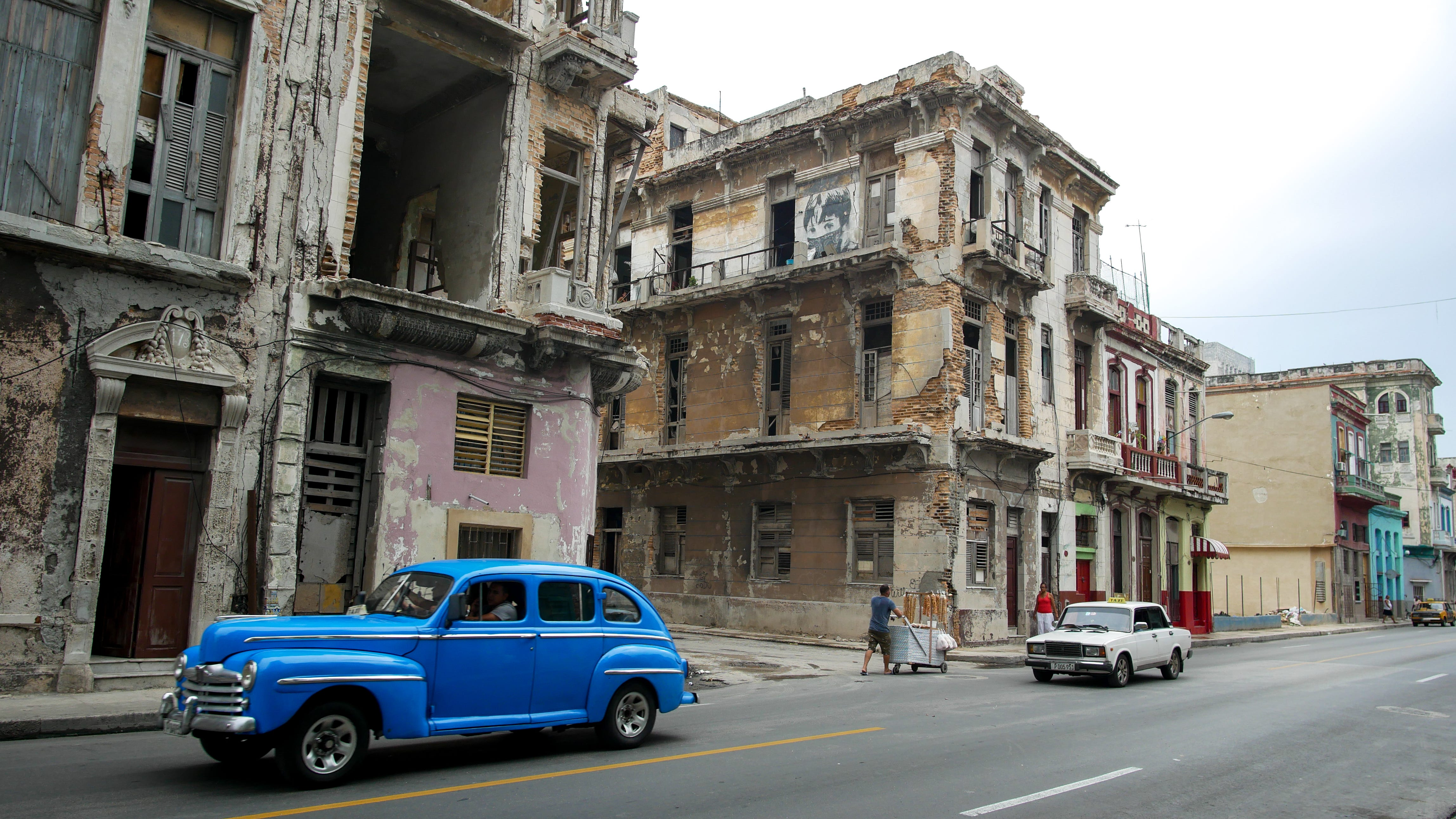 Buildings a block from Havana's famed Malecón, a seaside walkway stretching more than four miles, show the ravages of time and weather. Photo: Tracey Eaton.