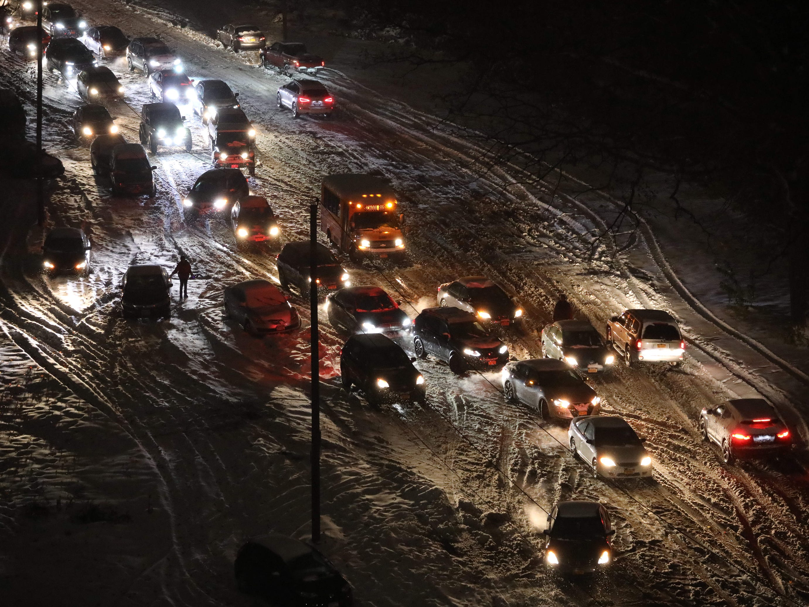 It's a virtual free for all as evening commuters try to navigate icy, snow covered roads in Yonkers, N.Y. on Nov. 15, 2018.