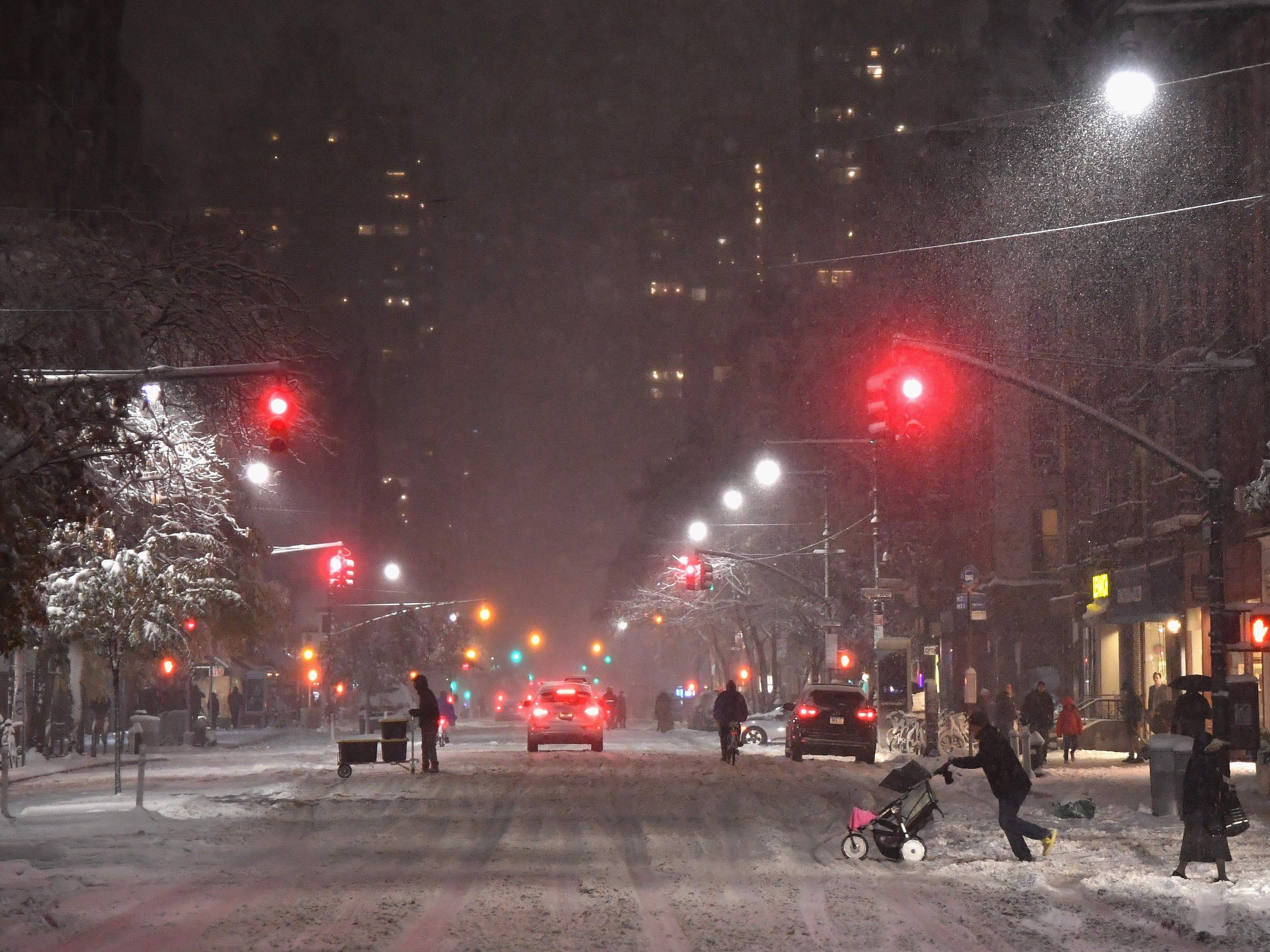 Pedestrians walk through snow in Manhattan on Nov. 15, 2018, in New York.