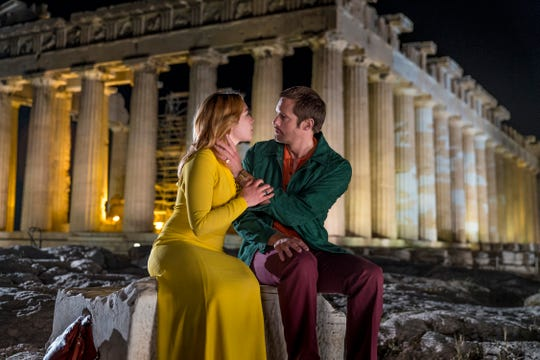 Charlie (Florence Pugh, left) and Becker (Alexander Skarsgard) share a moonlight kiss at the ancient Acropolis in Greece.