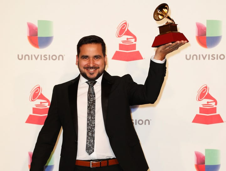 Miguel Siso holds the trophy for Best Instrumental Album.