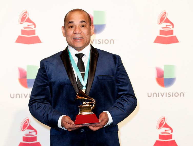 Milton Salcedo holds the award for Best Arrangement.