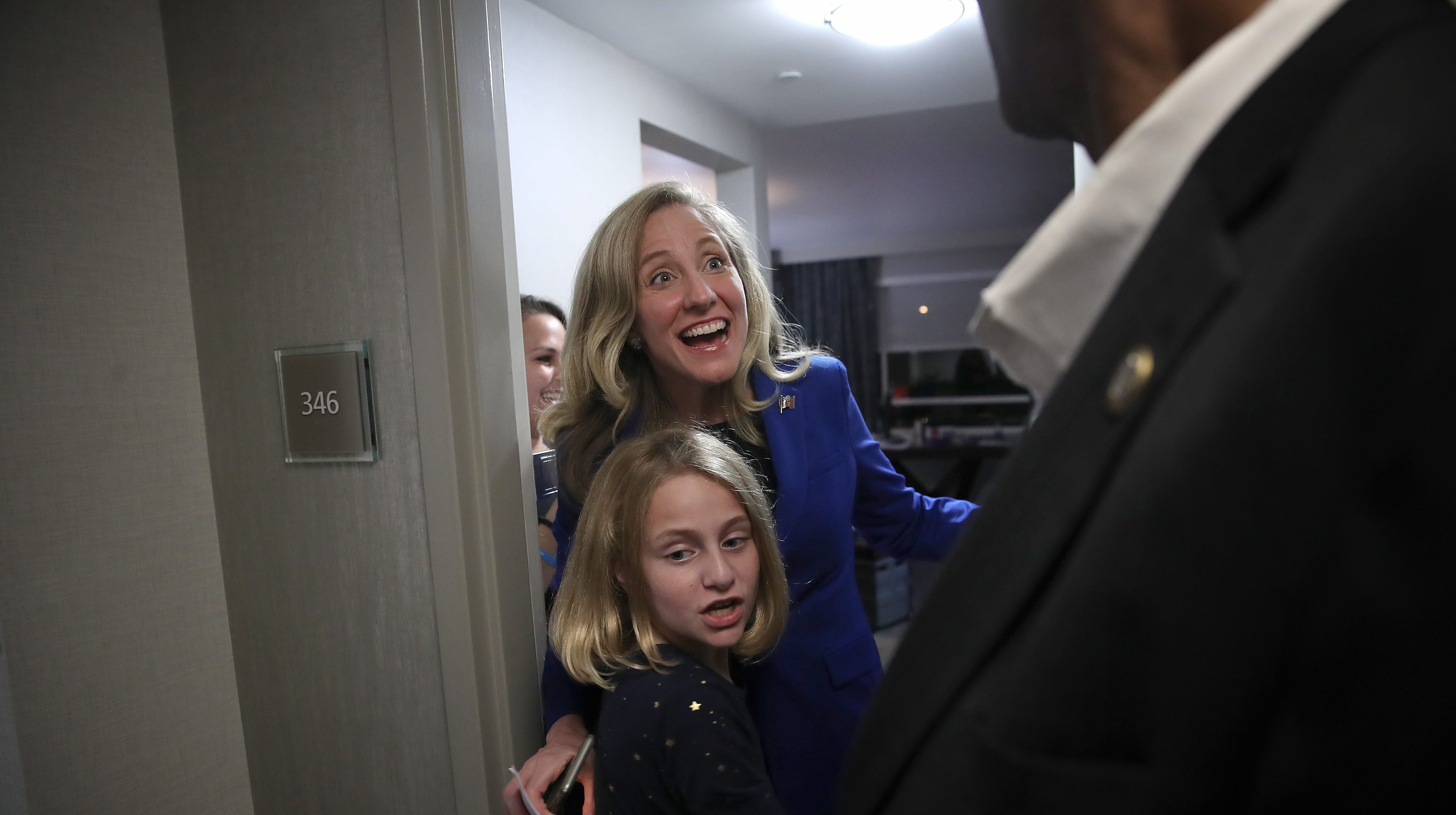 Abigail Spanberger, congresswoman-elect in Virginia's 7th District, celebrates with her daughter Clarie and members of her campaign staff on Nov. 6, 2018 in Richmond, Va., after hearing that the Democratic party was on track to regain control of the House of Representatives.