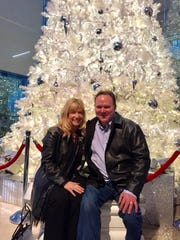 Marie Boggs and her husband Jonathan pose together during last year's holiday season.