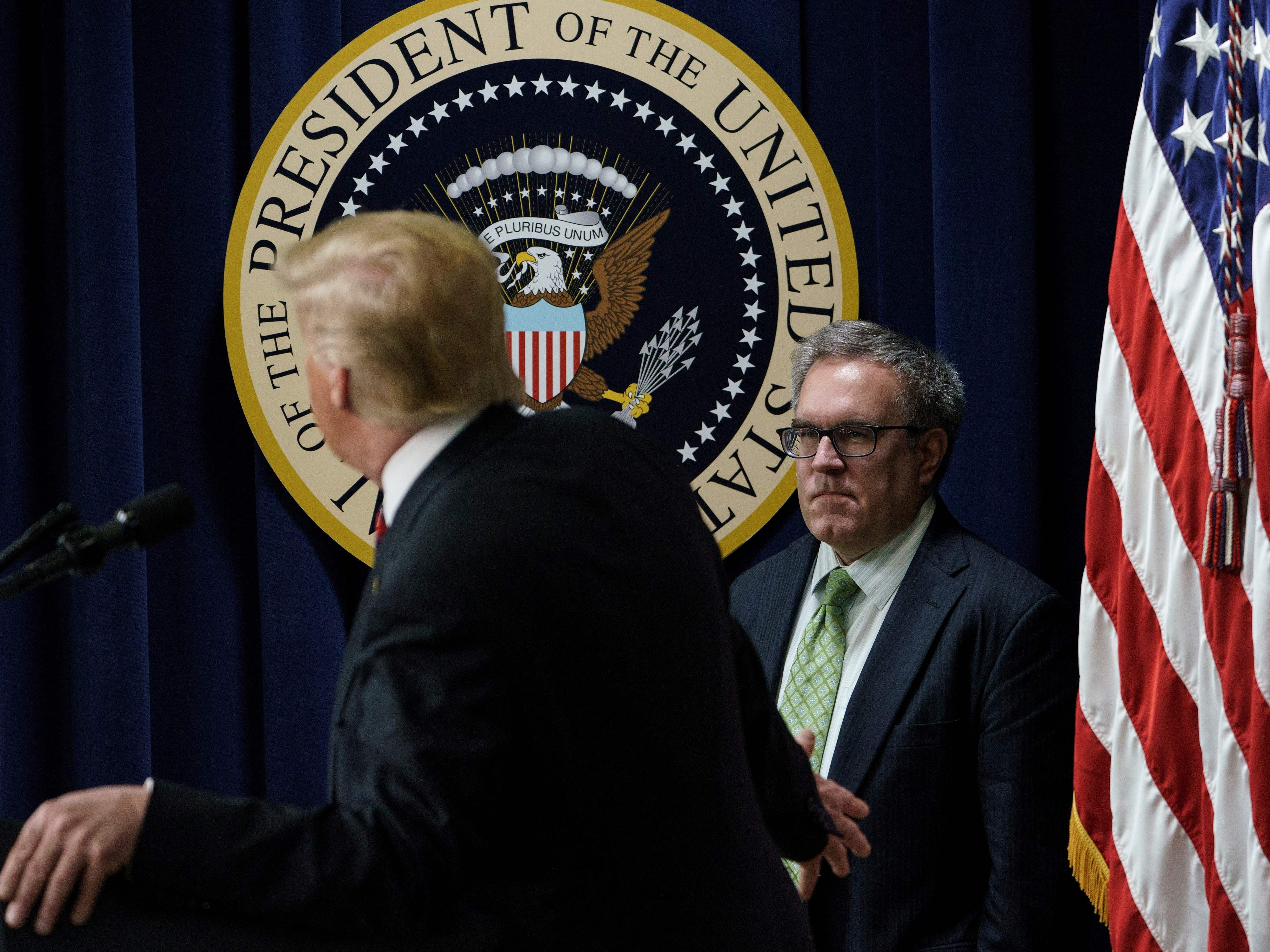 US President Donald Trump (L) gestures to EPA Acting Administrator Andrew Wheeler while talking to people from Hawaii, Alaska, and California during an event in the Eisenhower Executive Office Building on the White House campus October 23, 2018 in Washington, DC. (Photo by Brendan Smialowski / AFP)BRENDAN SMIALOWSKI/AFP/Getty Images ORIG FILE ID: AFP_1A917T