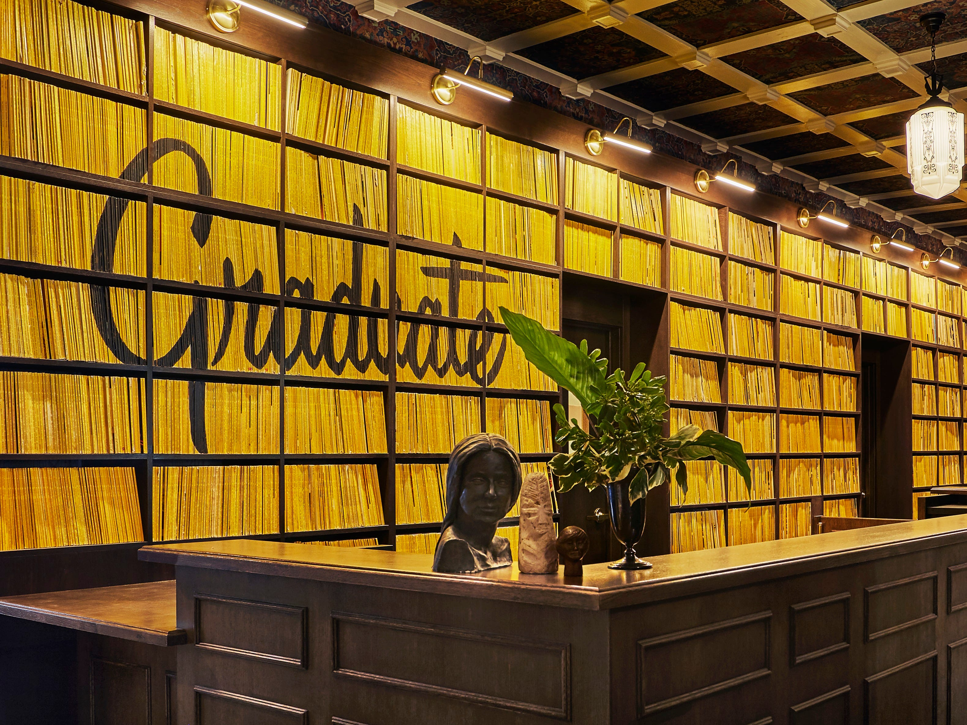 The playful Graduate Hotel in Berkeley, California, pays homage to the University of California, Berkeley with clever decorations including a wall of National Geographic magazines behind the counter, and  even a bong-shaped lamp in guest rooms.