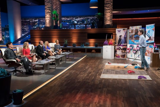 Eben Dobson III, an entrepreneur from San Marcos, California, pitches his one-handed pull broom and dustpan to wary sharks on ABC's 'Shark Tank.'