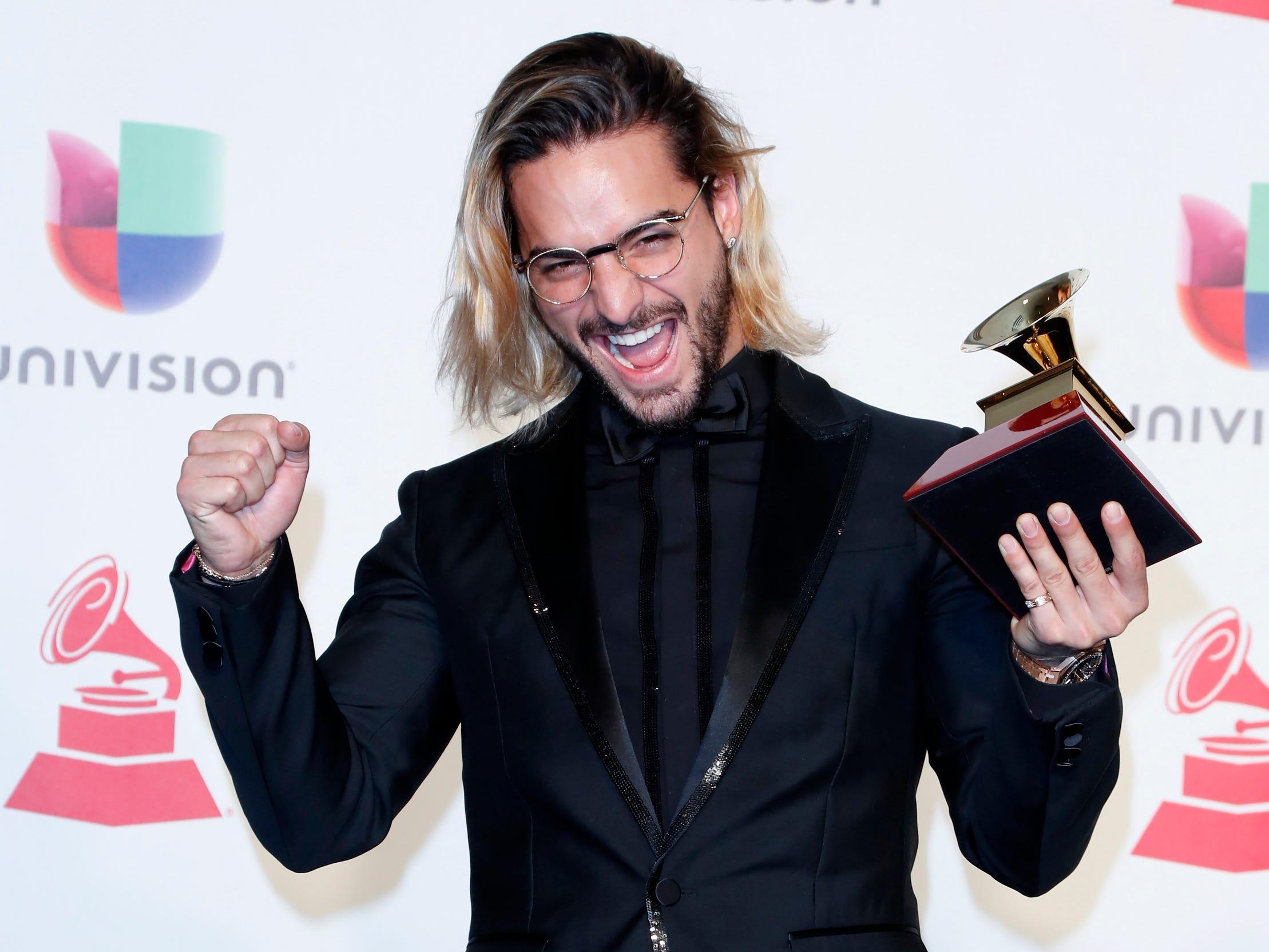 Maluma with the award for Best Contemporary Pop Vocal Album.