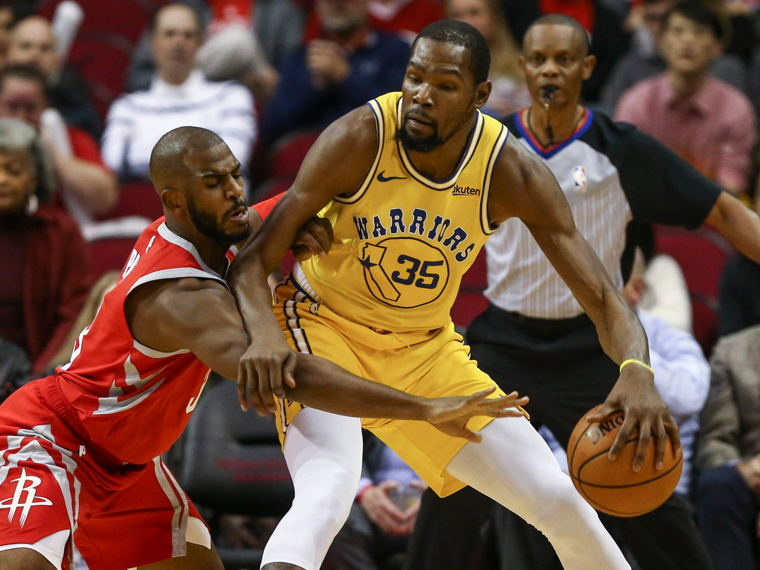 Nov. 15: Warriors forward Kevin Durant (35) tries to back down Rockets guard Chris Paul (3) during the first half in Houston.